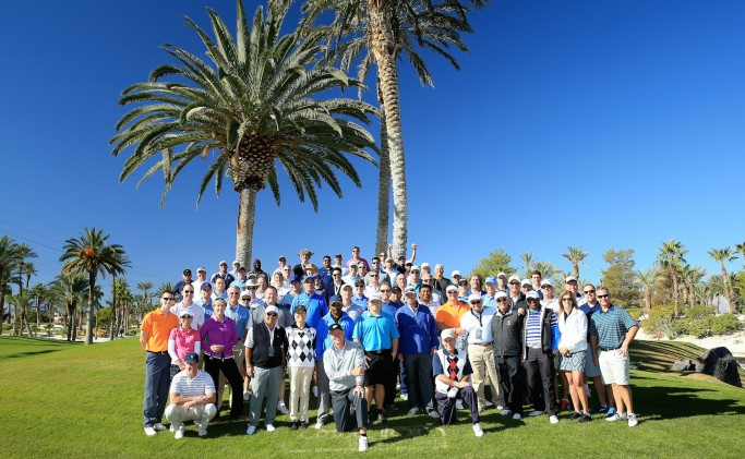 LAS VEGAS, NV - NOVEMBER 14: Ernie Els of South Africa is joined by all the players for a group picture during the 2015 Els For Autism Golf Challenge Finale at the Bali Hai Golf Club on November 14, 2015 in Las Vegas, Nevada. (Photo by David Cannon/Getty Images)