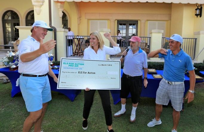 PALM BEACH GARDENS, FL - MARCH 07: Ernie Els of South Africa holds the cheque with his wife Liezl Els showing the extra one million dollars to the money raised at the pro-am organised by Marvin Shanken the publisher of Wine Spectator and Cigar Aficionado magazines (r) after Rickie Fowlerof the United States (r) had just holed in one in the $1 million Hole-In-One Challenge sponsored by SAP and Ketel One Vodka for the Els for Autism Foundation's Center of Excellence in Jupiter, Florida during the Els for Autism Pro-am at the Old Palm Golf Club on March 7, 2016 in Palm Beach Gardens, Florida. (Photo by David Cannon/Getty Images)