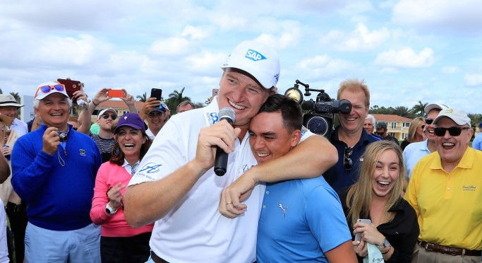 DORAL, FL - MARCH 06: Rickie Fowler of the United States is embraced by Ernie Els after he had just holed in one in the $1 million Hole-In-One Challenge sponsored by SAP and Ketel One Vodka for the Els for Autism Foundation's Center of Excellence in Jupiter, Florida during the Els for Autism Pro-am at the Old Palm Golf Club on March 7, 2016 in Palm Beach Gardens, Florida. (Photo by David Cannon/Getty Images)